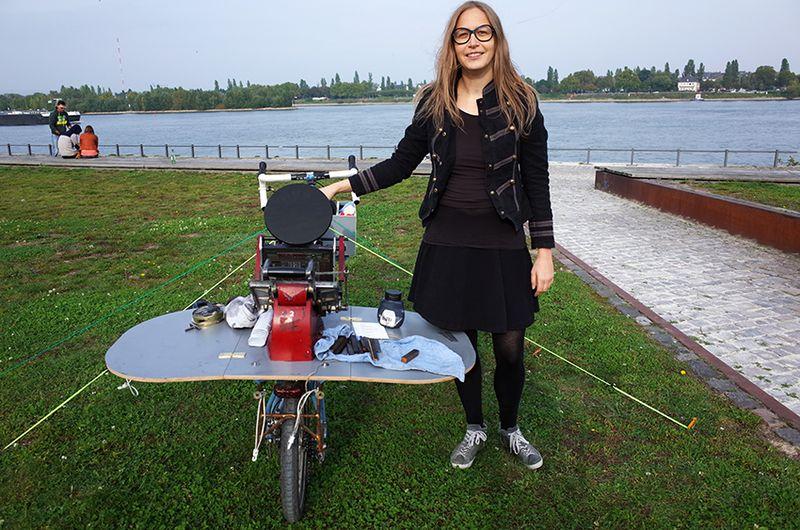 Sabina with bike by Rhine